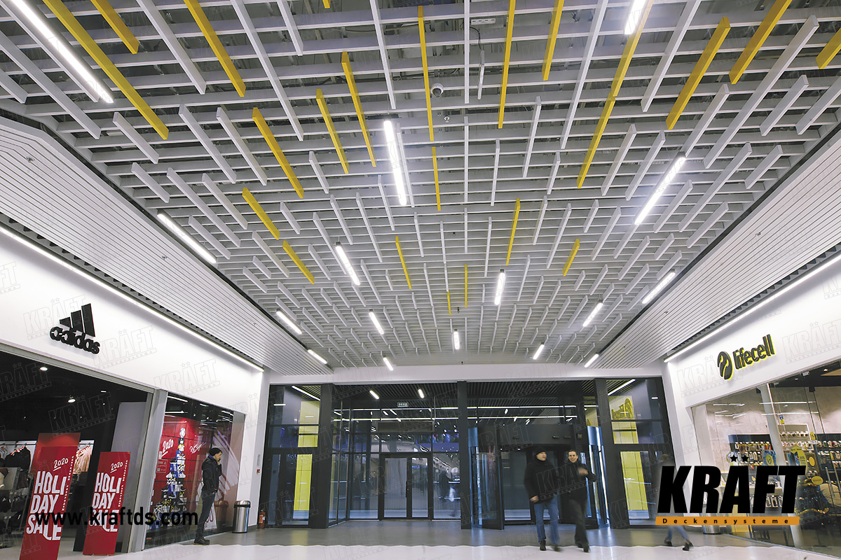 "Multilevel ceiling from KRAFT rail in the shopping center ""Caravan"". Custom ceiling design and new engineering solutions"