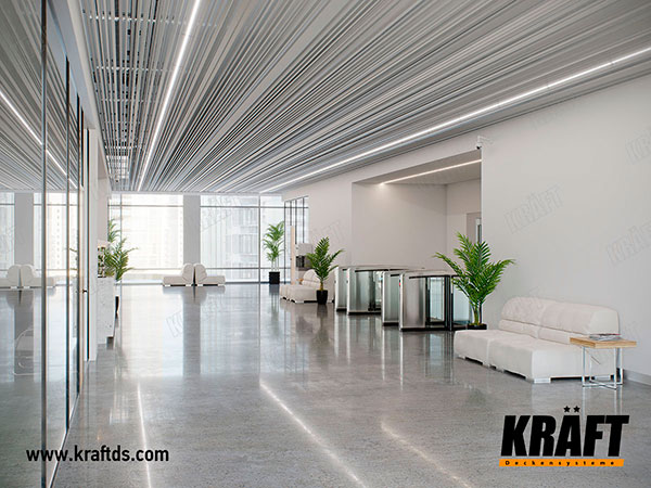 Lamellar screen ceiling with KRAFT Led lighting system in an office center