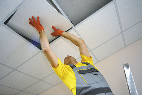 Installation of an acoustic panel in a false ceiling